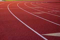 Track and field. The curve of an all weather track at a local high school Royalty Free Stock Photos