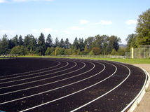 Track and Field. A high school track, with a baseball field in the background Royalty Free Stock Photo