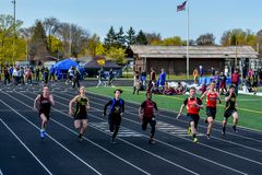 Track and Field Athletes Running Sprint
