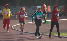 Track and field athletes to follow the path of healthy elderly a Stock Images