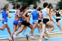 Track and Field blur. Running blur of group of girls during a track & field (Athletic) competition Royalty Free Stock Photo