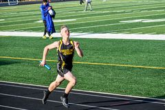 Track and Field Athlete Running Relay