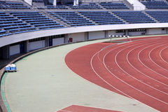 Track and field runway and empty seats Stock Image