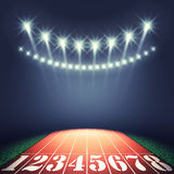 Track and field stadium. Track lanes and floodlights , Athletics event Stock Images