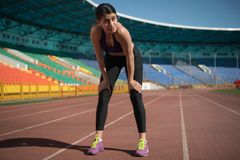 Track and field woman having a short break stock image