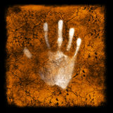 Track in history. A hand print on a textured grunge background Stock Images