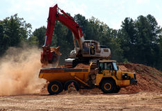 Track Hoe and Dump Truck Royalty Free Stock Image