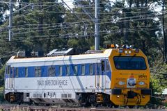Track inspection vehicle for NSW State Rail travels along the railway tracks in the blue mountains on an inspection run royalty free stock photo