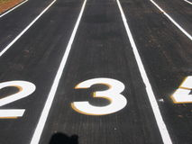 Track lanes. Closeup of a track an field stadium and the lane numbers Royalty Free Stock Photos