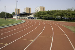 Track lanes close to a turn. Track and field lanes in a stadium.This is the a turn coming up royalty free stock image