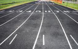 Track with lanes and hurdles. Track laid out with numbered lanes and hurdles used in competition stock photo