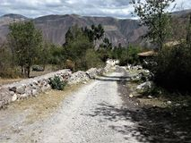 Track leading towards the Sacred Valley, Peru. Rough walled track which forms part of the Lares Trek looking towards the Sacred Valley, Peru royalty free stock photography