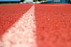 Track Line. Red running tracks with single white line Stock Photography