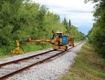 Track Maintenance. A machine trims bush and grass beside railway tracks in Richmond, British Columbia Stock Image
