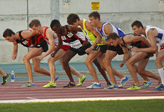 Track many male athletes race start canada. Start of the 5,000-meter run at the Canadian Track & Field Championships June 22, 2013 in Moncton, Canada Stock Image