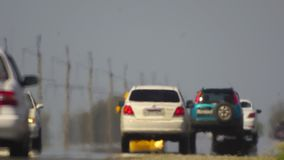Track. The movement of vehicle on a road. Car traffic. Highway. Cars on a country road. Cars moving in two directions on. Road the background of traffic stream stock footage