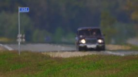Track. The movement of vehicle on a road. Car traffic. Highway in summer day. Cars on a country road. Cars moving in two. Road the background of traffic stream stock footage