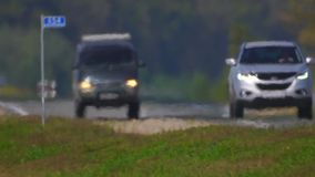 Track. The movement of vehicle on a road. Car traffic. Highway in summer day. Cars on a country road. Cars moving in two. Road the background of traffic stream stock video footage