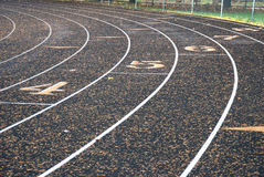 Track Numbers. Rounding the curve of the Roseburg High School Track in Roseburg Oregon royalty free stock photography