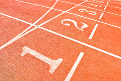 Track numbers. Lanes of a running track in a olympic stadium royalty free stock images