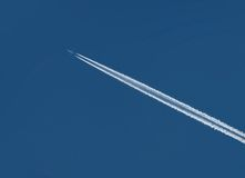 Track of plane. In a blue sky Stock Photo