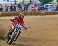 Track racing event. Motorcycle racer runs the curve at the racing professional event Stock Photography
