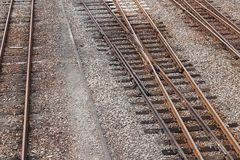 Track of rails with old timber sleepers. Railroad at railway junction station. line of track crossing in countryside Stock Image