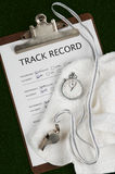 Track Record. On clip board with stop watch, whistle and towel Royalty Free Stock Photography