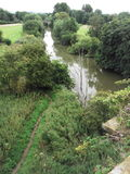 A track by the River Derwent weaves through the fields and trees Royalty Free Stock Photos