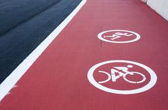 Track for roller skating and cycling with a painted sign Royalty Free Stock Image