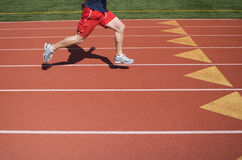 Track Run. A runner on a running track Stock Photo