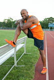 Track Runner Stretching Stock Images