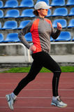 Track running. Women running on the track, blured motion Royalty Free Stock Image