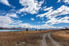 Track running alongside Lake Tekapo Royalty Free Stock Photography