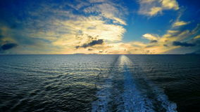 Track ship in the sea at sunset stock footage