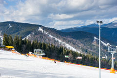 Track for skiers against mountain view in a ski-resort. On a sunny day in winter period Royalty Free Stock Photos
