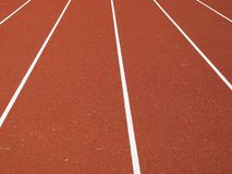 Track tartan athletics. Tartan track is the trademarked all-weather synthetic track surfacing for athletics made of polyurethane. It lets athletes compete in bad royalty free stock photo