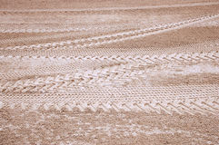 Track of tires on sand Stock Images