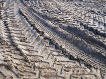 Track of tractor tires wheels on mud ground. Soil agriculture background image Stock Images
