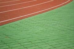 Track field for run. Trail path line run sport race ground texture stock photo