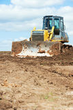 Track-type loader bulldozer excavator at work Stock Image