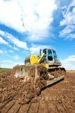 Track-type loader bulldozer excavator at work Royalty Free Stock Image
