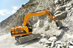 Track-type loader excavator at mountain work Stock Photography