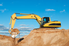 Track-type loader excavator at sand Stock Photo