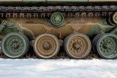 Track and wheels of the old tank in winter Stock Image