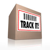 Track It Words Package Tracking Shipment Logistics. The words Track It with barcode on a package shipment label to trace the shipment of a cardboard box shipped Royalty Free Stock Photography