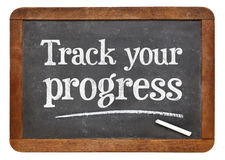 Track your progress advice on blackb oard Royalty Free Stock Image