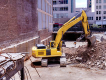Construction backhoe clearing a basement pit Stock Photography