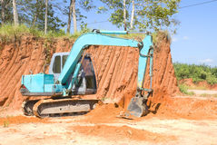 Tracked excavator. Worked of the track excavator Stock Image