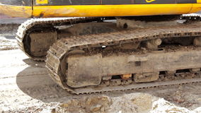Tracked excavator. Construction and repair of roads, rides on tracked excavator machine soil with sand stock video footage